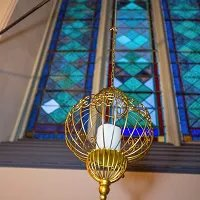 Maine Wedding Venue amenities honeymoon suite stained glass